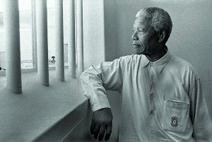N.Mandela in his cell on Robben Island (revisit} 1994